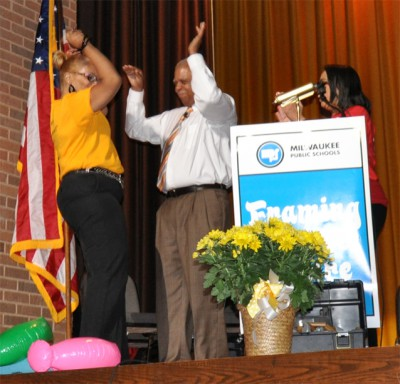 Brown Street Academy Principal Ava Morris gives MPS Superintendent Gregory Thornton a double high-five after hearing her school won a $25,000 Target grant.